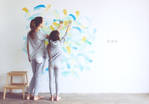 mother daughter painting wall