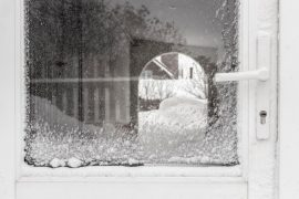 storm door covered with snow