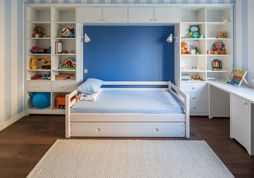 striped blue and white kids room with shelves
